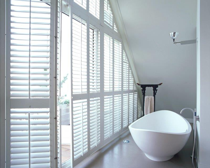White Decowood Shutters by American Shutters